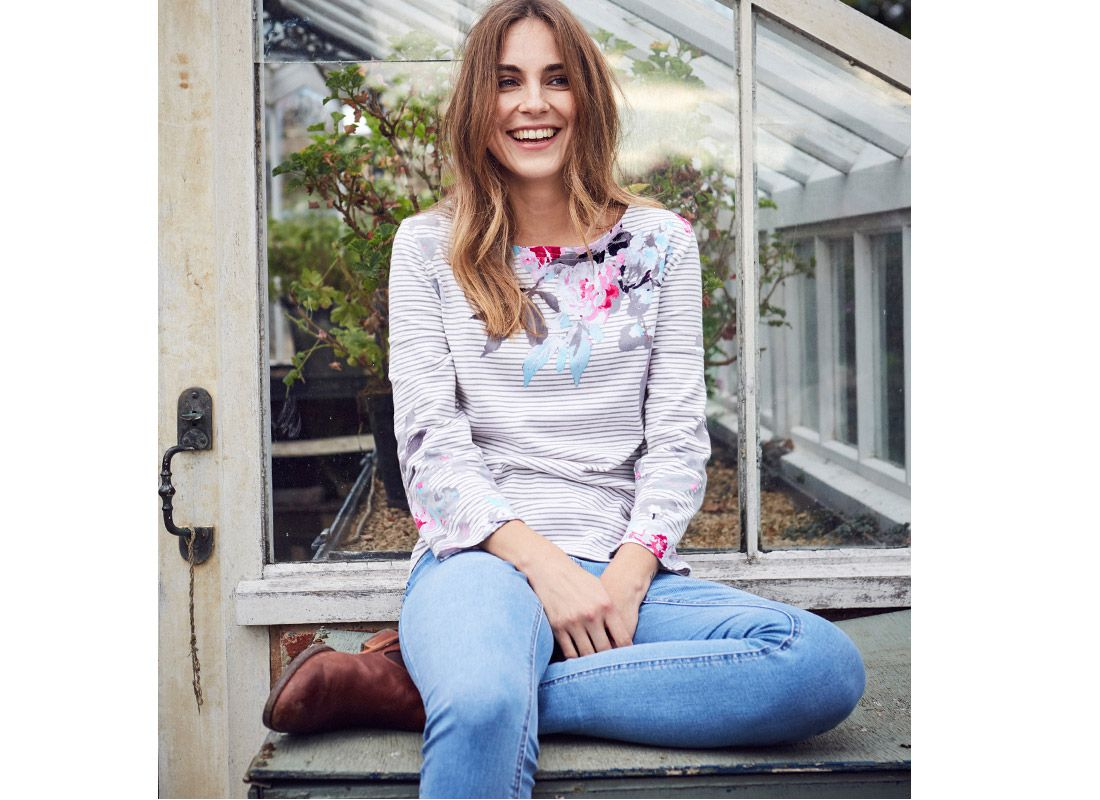 female modeling joules denim skinny jeans and striped breton top