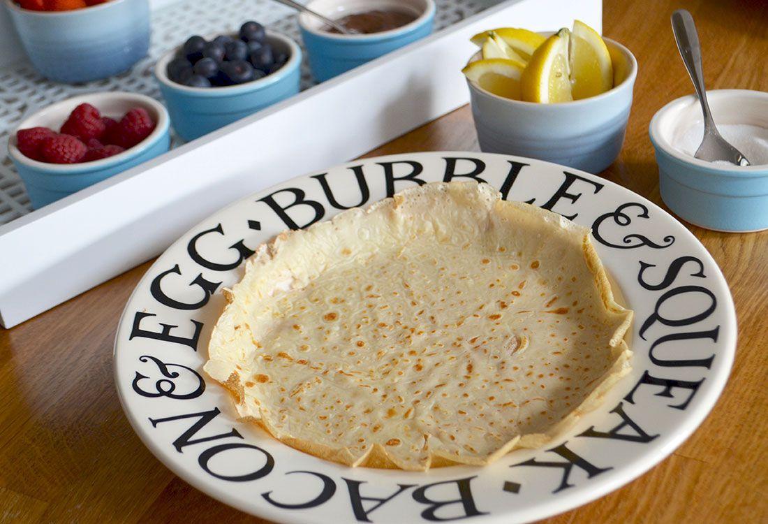 pancake surrounded by pancake topping ingredients