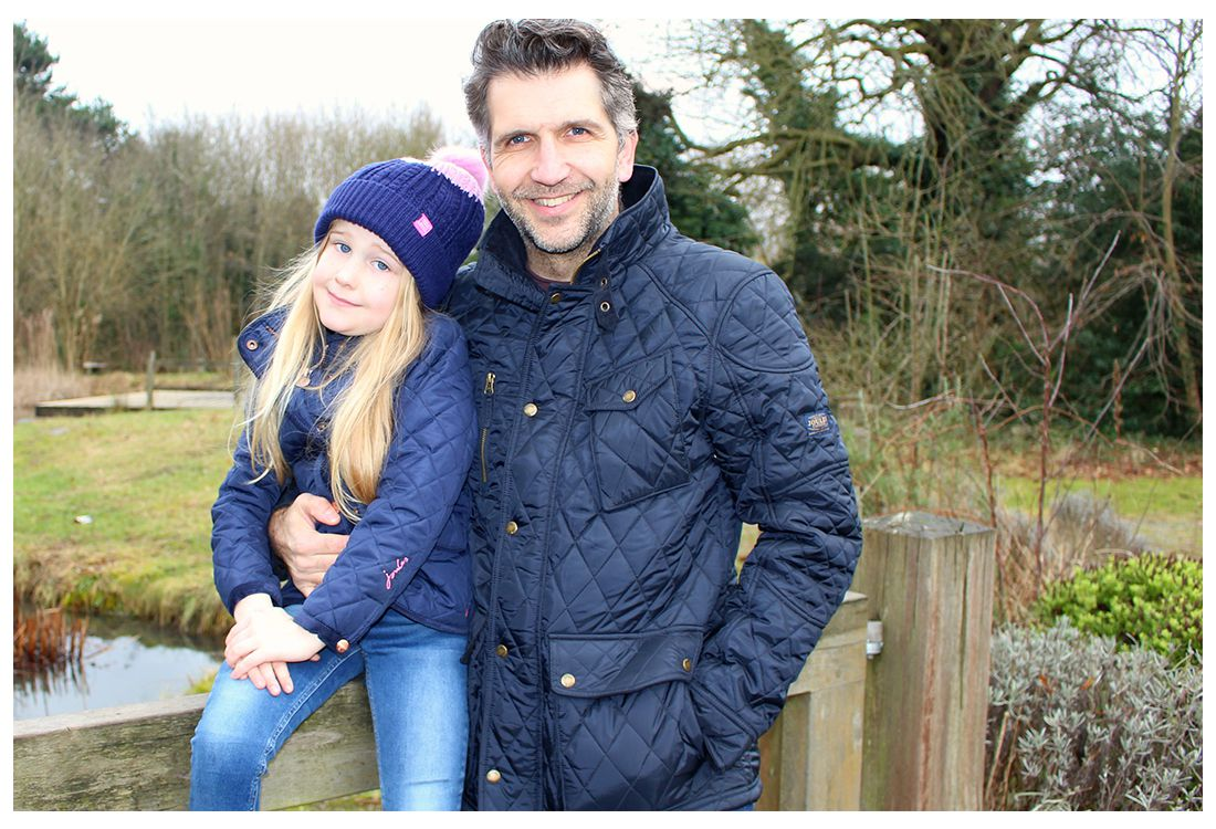 father wearing quilted newdale coat with daughter