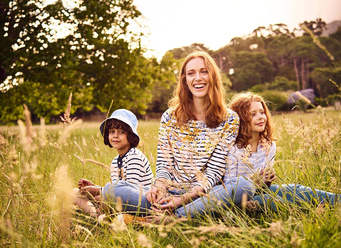 joules family in sunny landscape wearing classic striped breton top