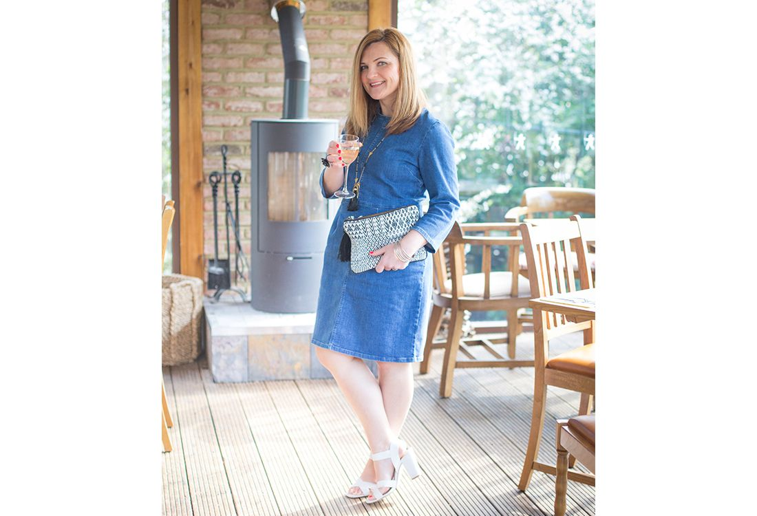 blogger tinker styles denim dress for night out wear with heels and clutch bag to dress it up