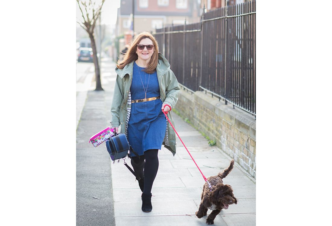 blogger tinker styles denim jacket with gold belt with khaki parka style jacket walking dog on the school run
