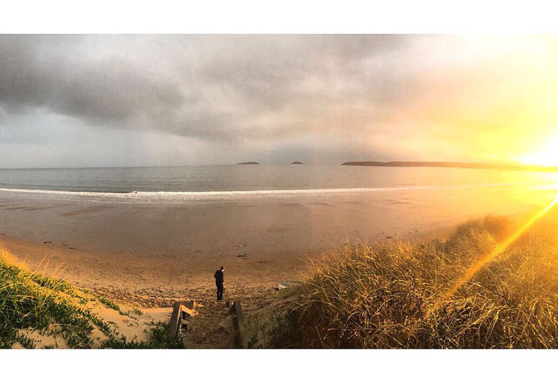the abersoch beach with the sun set