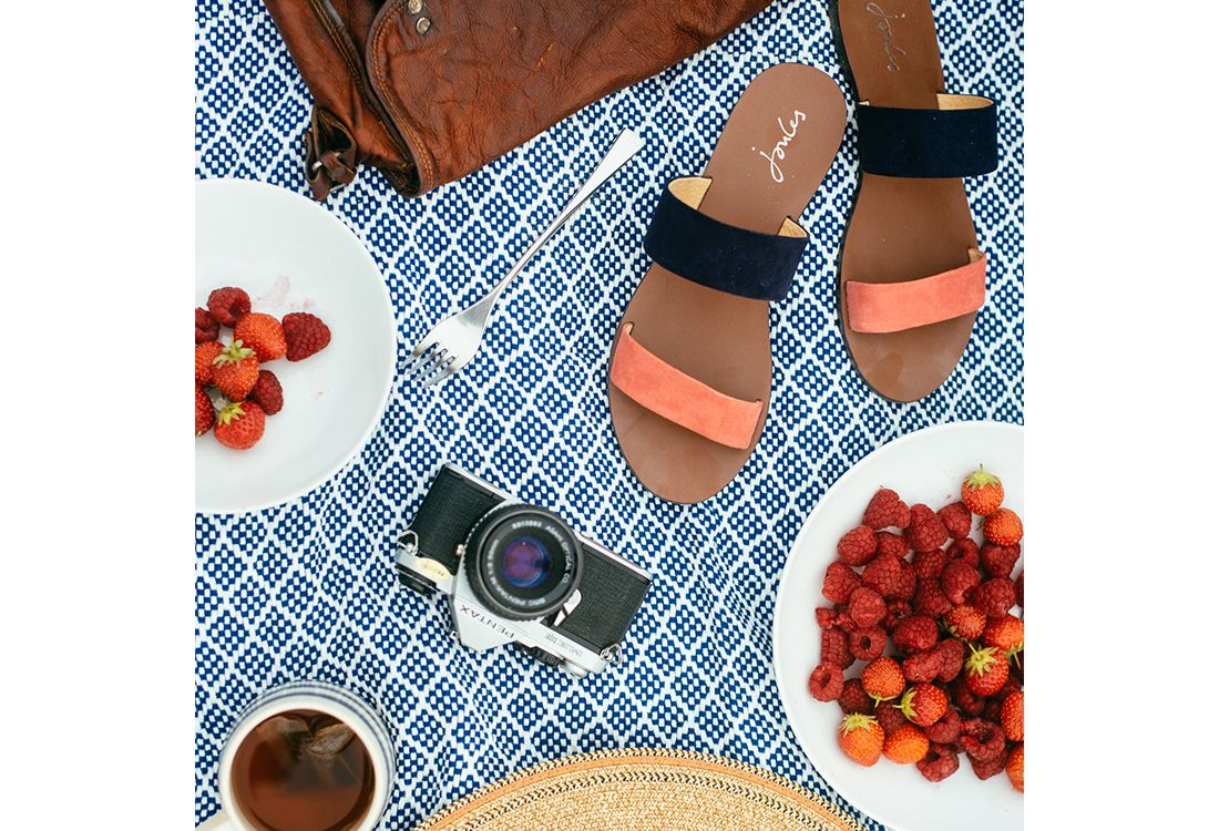 Joules perfect picnic rug with fresh strawberries and suede sandals