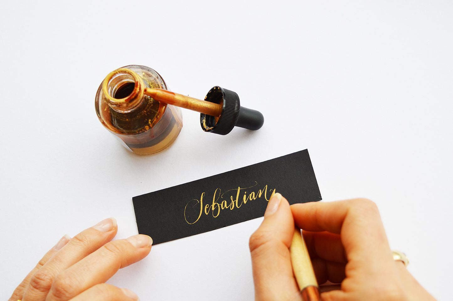 This Christmas, if you're either hosting a tea party or even dinner on the day itself, make your guests feel extra special by creating eye-catching place cards. We asked our friends at Quill London to share their hints and tips about the art of calligraphy – plus how to use the art of calligraphy to make those fancy festive place cards.