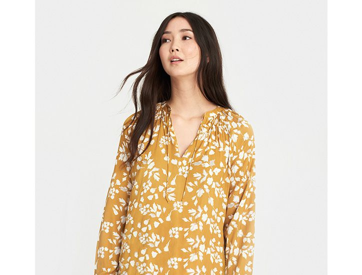 Joules floral tunic modeled by woman
