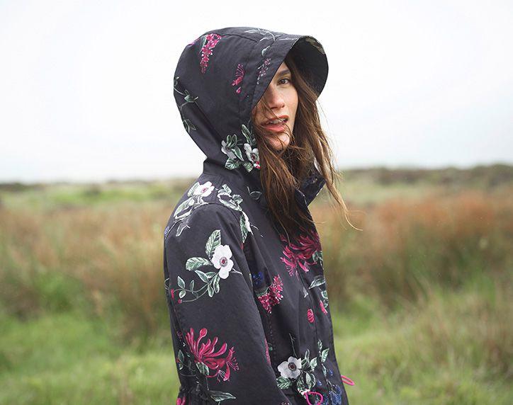 woman wearing joules raina raincoat