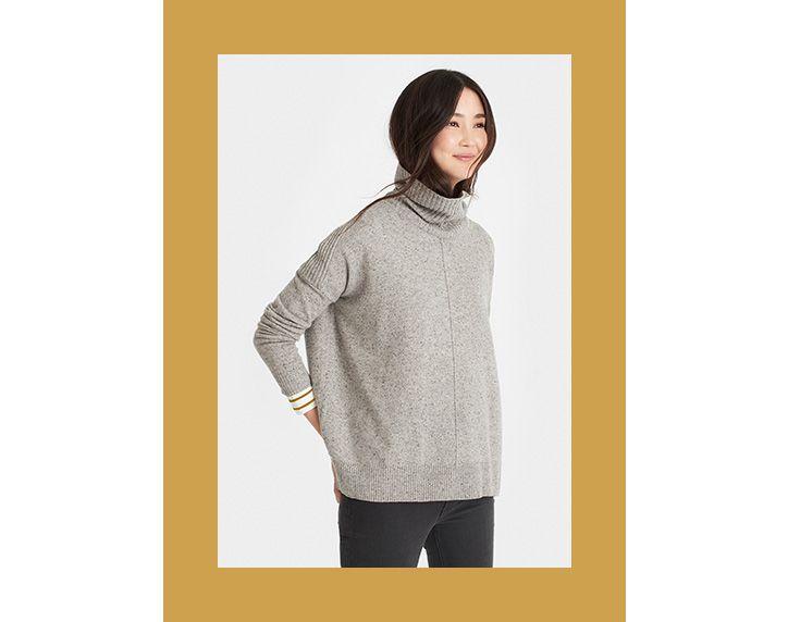 woman modelling the rolanda roll neck jumper