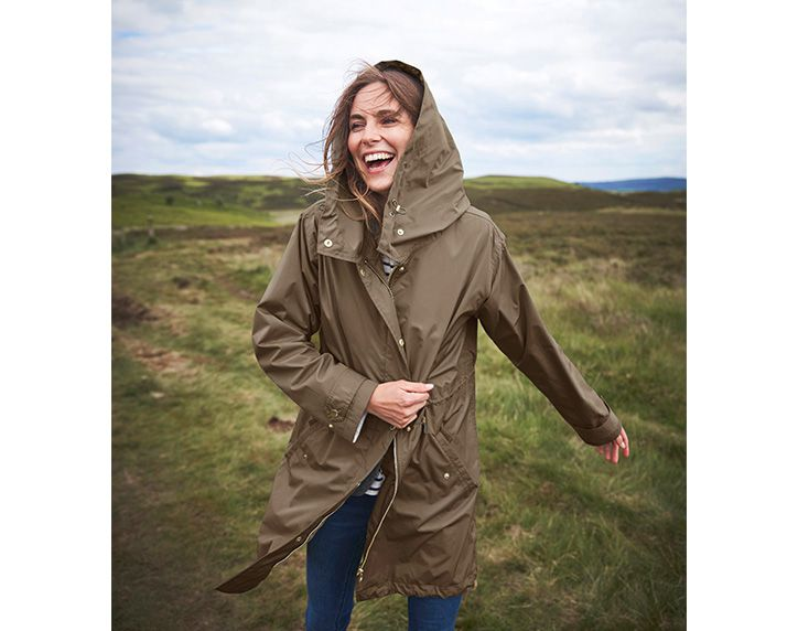 woman in the countryside in a raincoat