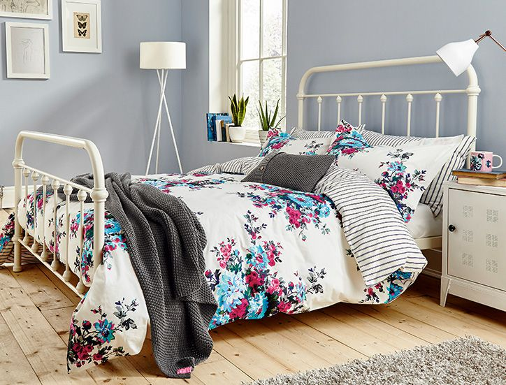 Joules printed duvet covers on a bed