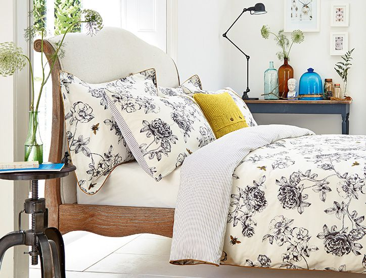 Joules Printed duvet covers on a bed spread