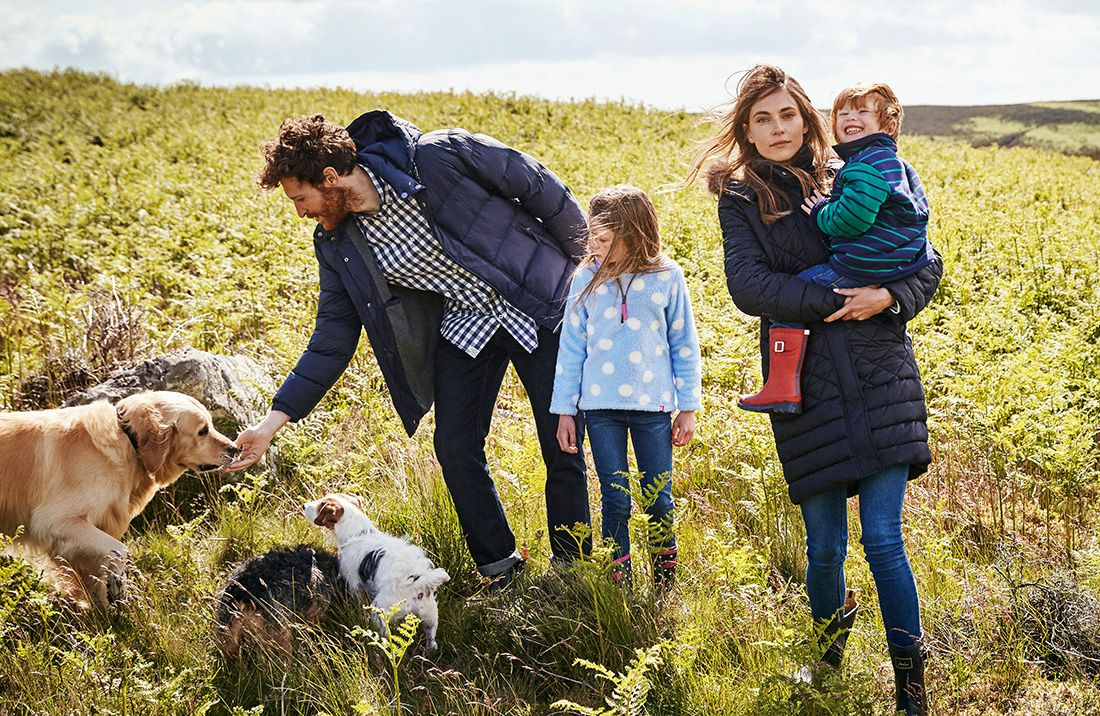 family exploring the countryside with joules autumn collection