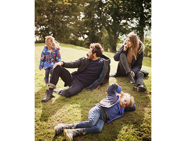 family sitting in the countryside