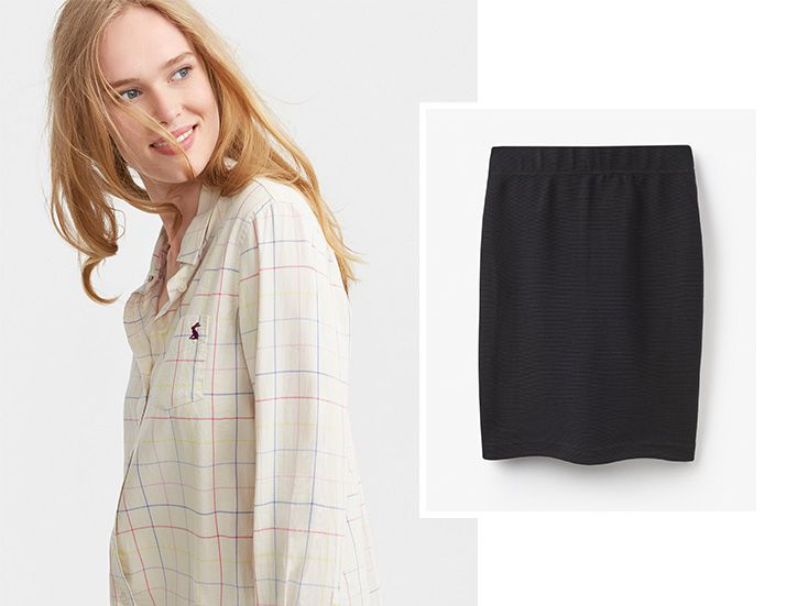 Woman modelling work shirt with tweed pencil skirt