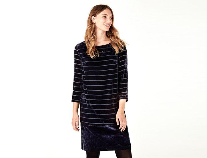 woman modelling velvet dress