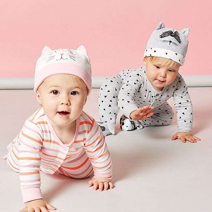 babys wearing joules printed babygrows