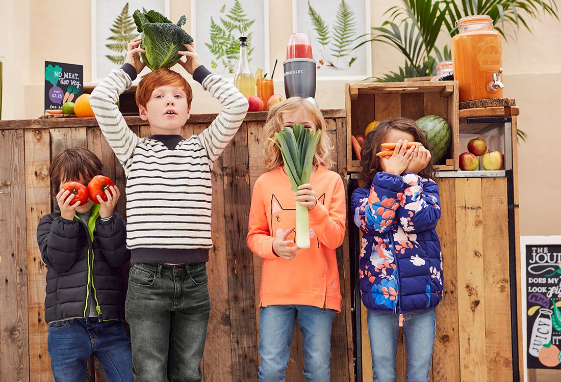 children playing around with fruit and veg