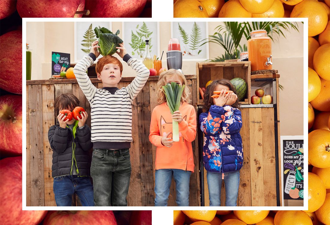 kids playing with fruit and veg in market shop
