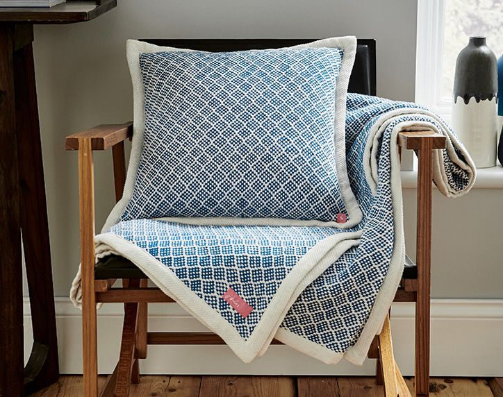 joules blue woven range of cushions and throughs