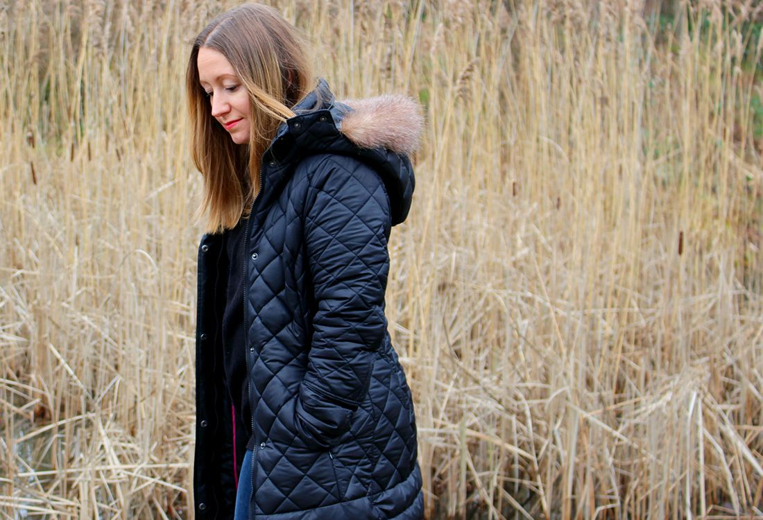 Running in Lavender lifestyle and fashion blogger wears waterproof coat in field