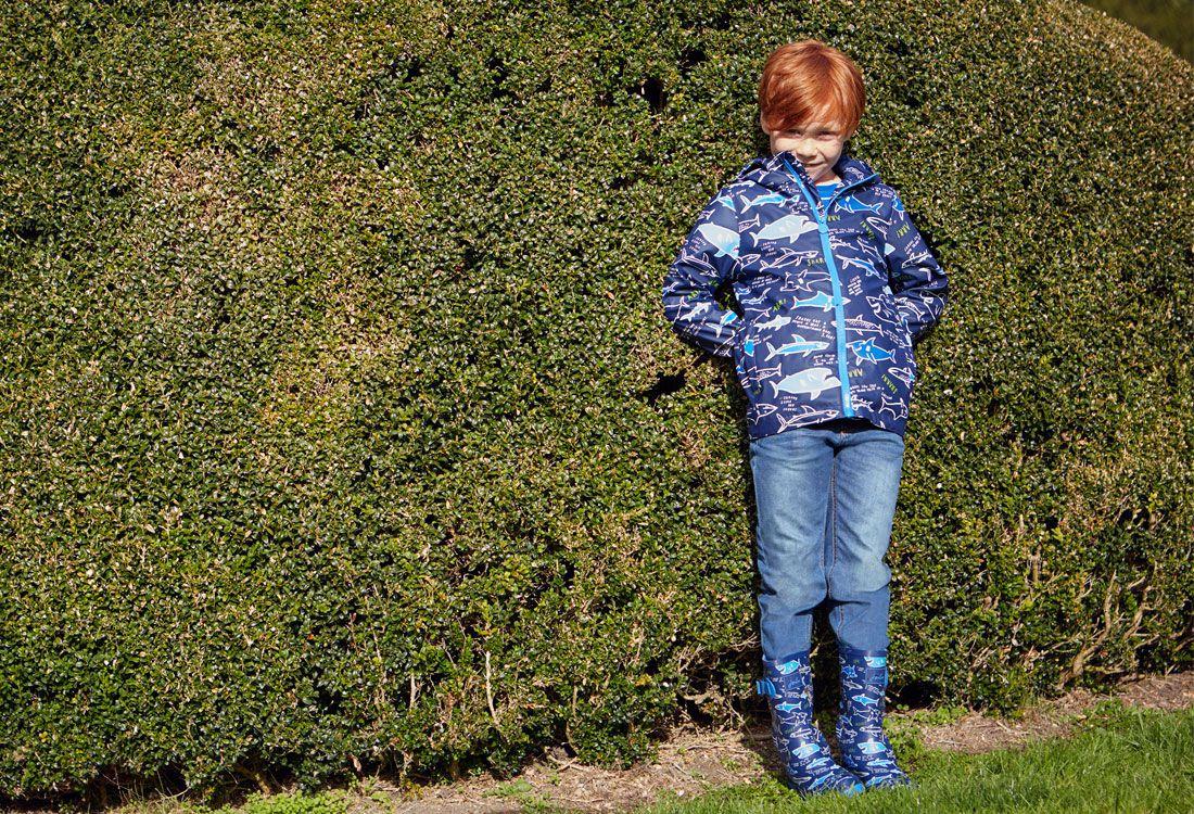 boys waterproof jacket in garden scene