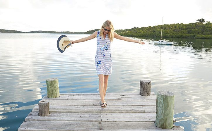 joules striped floral dress in summery scene