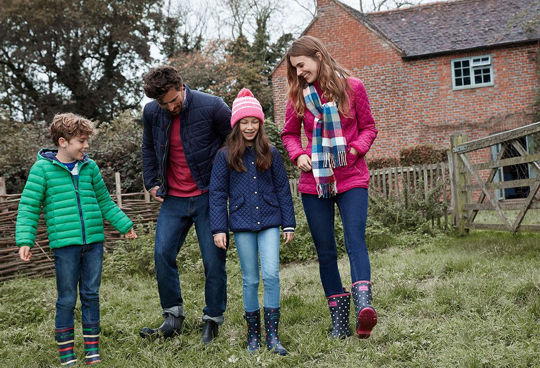 Joules new collection for spring summer 2018 - family walks through a country garden in their outerwear and wellies