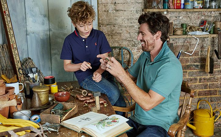 father and son play together in shed