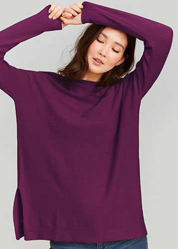 Woman wearing Joules purple jumper