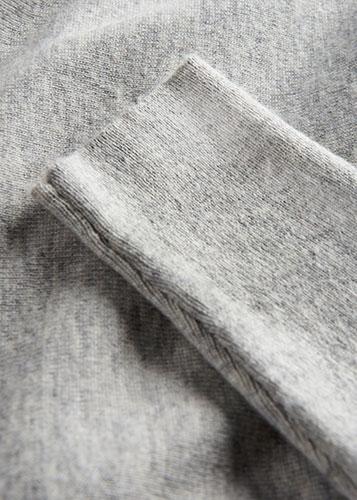 Close-up of grey woollen jumper