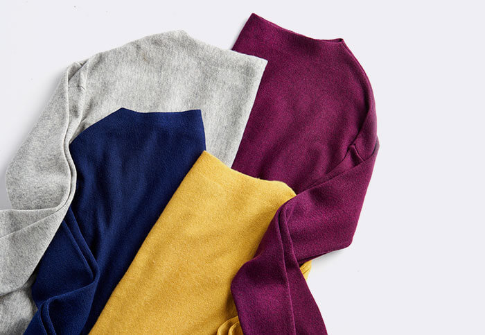 Close up of three Joules knitted jumpers